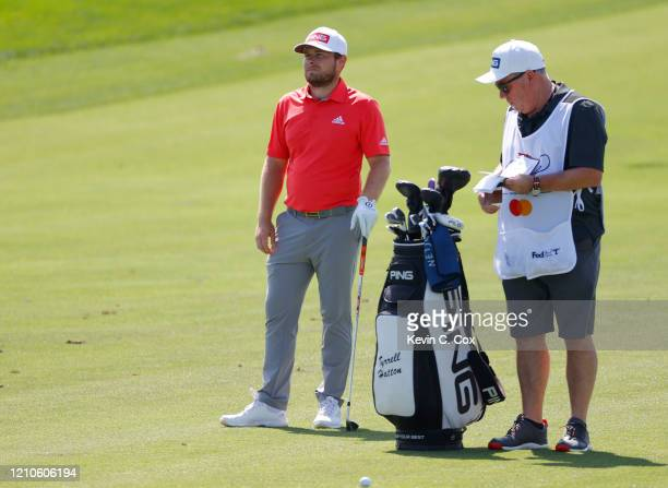 Tyrrell Hatton of England talks with his caddie Mick Donaghy on the 18th hole during the first round of the Arnold Palmer Invitational Presented by...
