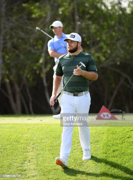 Tyrrell Hatton of England walking off of the 12th tee ahead of Rory McIlroy of Northern Ireland during the final round of the Abu Dhabi HSBC...