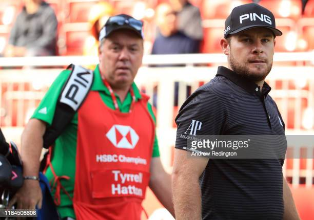 Tyrrell Hatton of England walks from the 10th tee with his caddie Mick Donaghy during Day One of the WGC HSBC Champions at Sheshan International Golf...