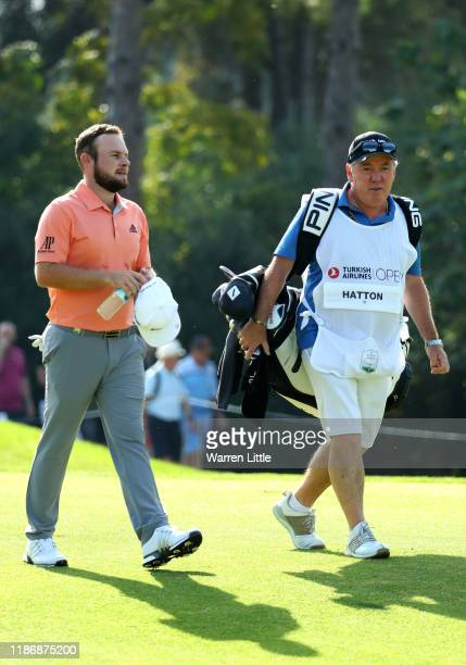 Tyrrell Hatton of England walks with his caddie Mick Donaghy during the final round of the Turkish Airlines Open at The Montgomerie Maxx Royal on...