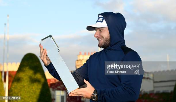 Tyrrell Hatton of England wearing his hoodie and holding the winners trophy after the final round of the BMW PGA Championship at Wentworth Golf Club...