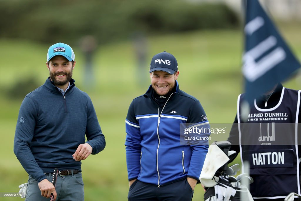 Tyrrell Hatton of England with his amateur partner Jamie Dornan after he had holed his second shot on the 16th hole for a birdie during the second round of the 2017 Alfred Dunhill Links Championship on the Championship Links at Carnoustie on October 6, 2017 in Carnoustie, Scotland.