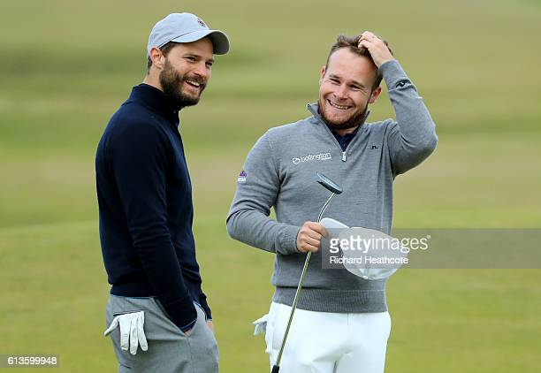 Tyrrell Hatton of England with his playing partner actor Jamie Dornan on the 12th green during the final round of the Alfred Dunhill Links...