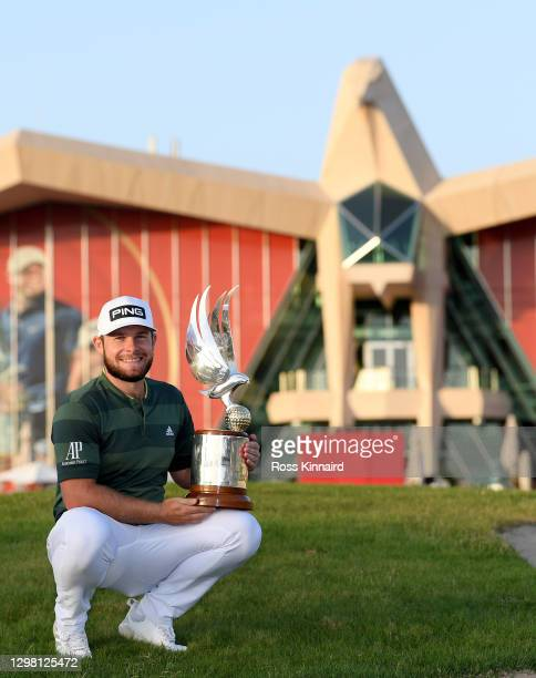 Tyrrell Hatton of England with the winners trophy after the final round of the Abu Dhabi HSBC Championship at Abu Dhabi Golf Club on January 24, 2021...