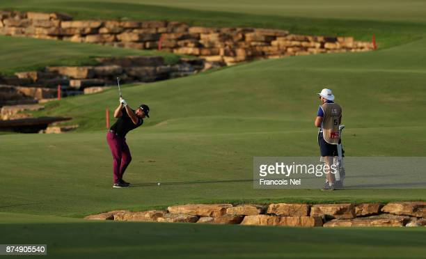 Tyrell Hatton og England plays his third shot on the 18th hole during the first round of the DP World Tour Championship at Jumeirah Golf Estates on...