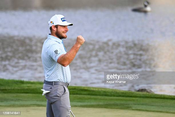 Tyrrell Hatton pumps his fist to celebrate his one stroke victory on the 18th hole green during the final round of the Arnold Palmer Invitational...
