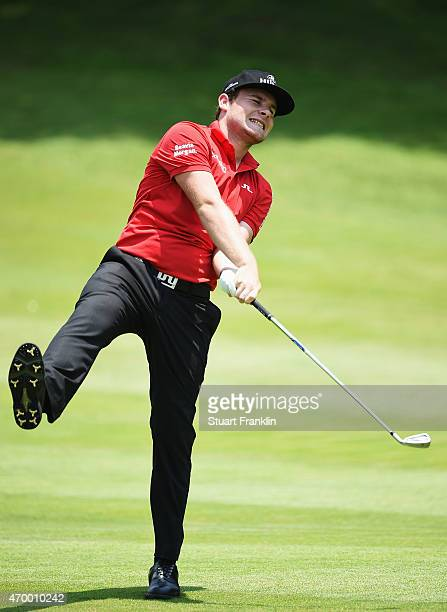 Tyrrell Hatton reacts to a shot during the second round of the Shenzhen International at Genzon Golf Club on April 17 2015 in Shenzhen China