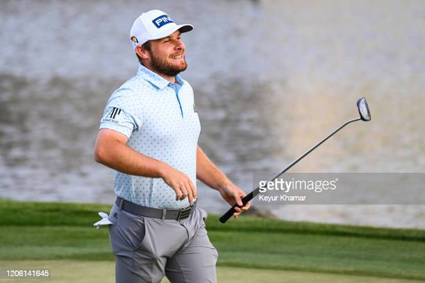 Tyrrell Hatton smiles as he celebrates his one stroke victory on the 18th hole green during the final round of the Arnold Palmer Invitational...