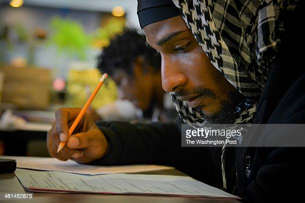 adult literacy program stock photos and pictures getty images tyrrell jefferson of dc writes an essay at the academy of hope adult literacy program on