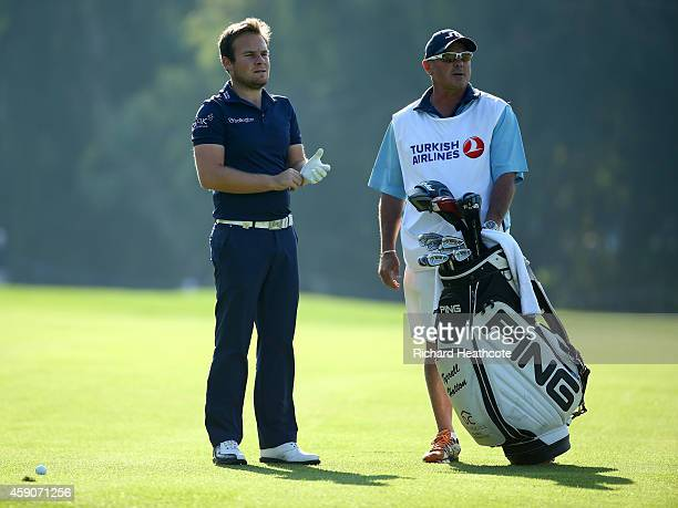 Tyrrelll Hatton of England with his caddy Kyle Roadley during the final round of the 2014 Turkish Airlines Open at The Montgomerie Maxx Royal on...