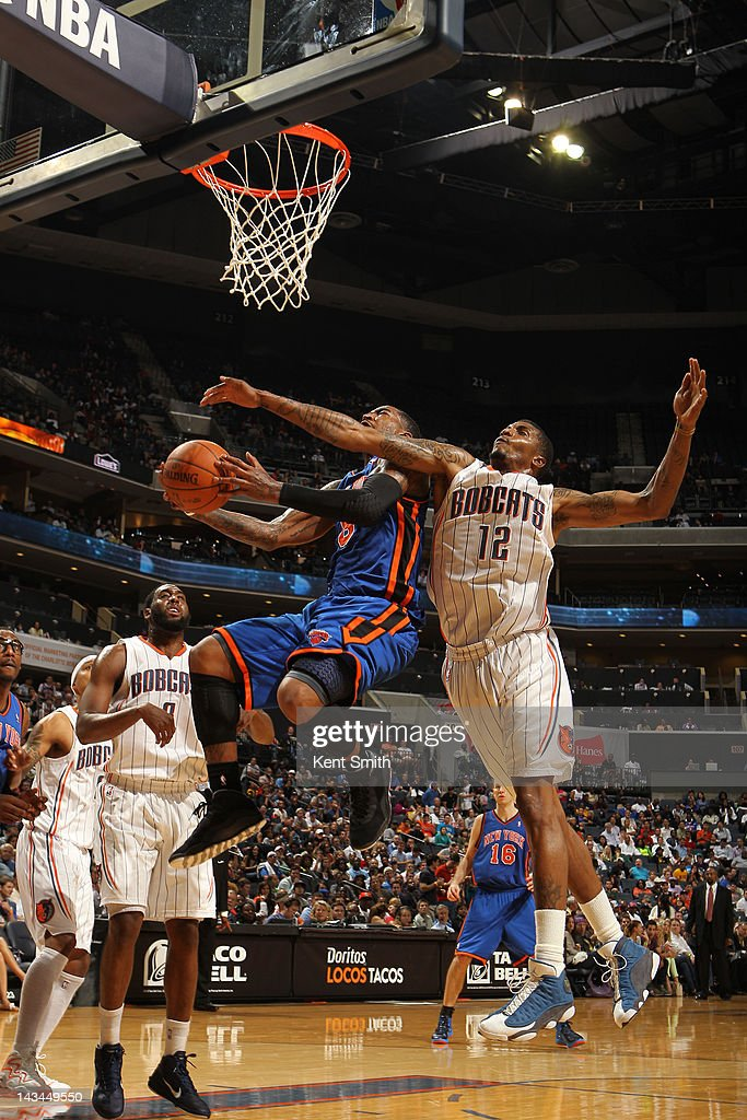 Tyrus Thomas #12 of the Charlotte Bobcats attempts the block against Jared Jeffries #9 of the New York Knicks at the Time Warner Cable Arena on April 26, 2012 in Charlotte, North Carolina.
