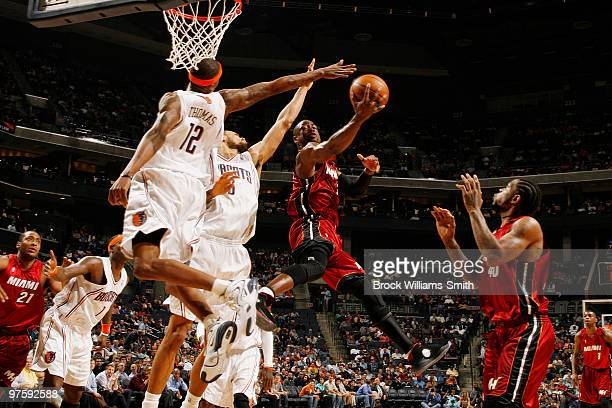 Tyrus Thomas of the Charlotte Bobcats blocks against the Miami Heat on March 9 2010 at the Time Warner Cable Arena in Charlotte North Carolina NOTE...