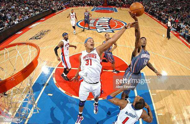 Tyrus Thomas of the Charlotte Bobcats goes up for a rebound against Charlie Villanueva of the Detroit Pistons in a game on November 5 2010 at The...