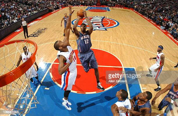 Tyrus Thomas of the Charlotte Bobcats goes up for a shot attempt against Greg Monroe of the Detroit Pistons in a game on November 5 2010 at The...