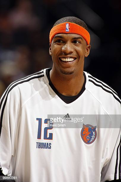 Tyrus Thomas of the Charlotte Bobcats looks on with a smile during the game against the Miami Heat at Time Warner Cable Arena on March 9 2010 in...