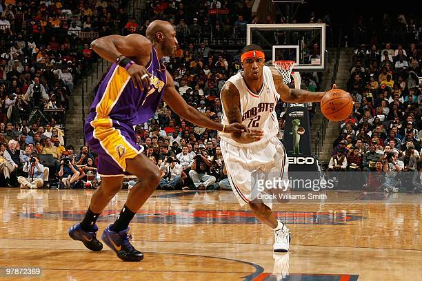 Tyrus Thomas of the Charlotte Bobcats moves the ball against Lamar Odom of the Los Angeles Lakers during the game on March 5 2010 at the Time Warner...