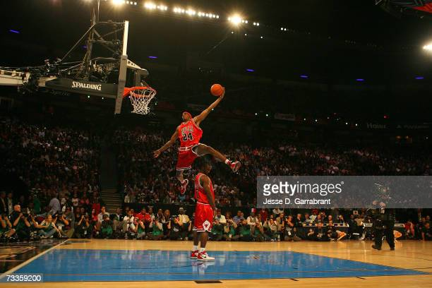 Tyrus Thomas of the Chicago Bulls dunks over teammate Ben Gordon during the Sprite Slam Dunk Competition at NBA All-Star Weekend on February 17, 2007...
