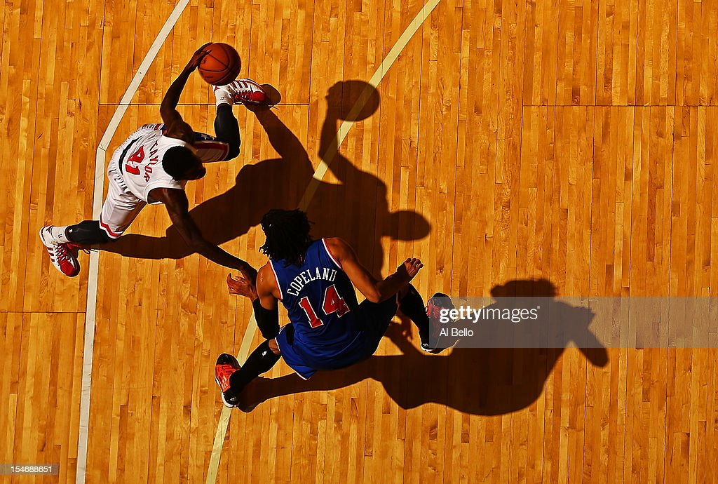 Tyshawn Taylor #41 of the Brooklyn Nets dribbles against Chris Copeland #14 of the New York Knicks during their game at the Nassau Coliseum on October 24, 2012 in Uniondale, New York.
