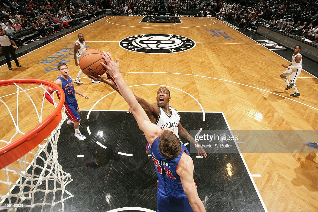Tyshawn Taylor #41 of the Brooklyn Nets shoots against Viacheslav Kravtsov #55 of the Detroit Pistons on April 17, 2013 at the Barclays Center in the Brooklyn borough of New York City.