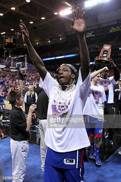 Tyshawn Taylor of the Kansas Jayhawks celebrates with the net around his net as he walks off of the court following their 80-67 win against the North...