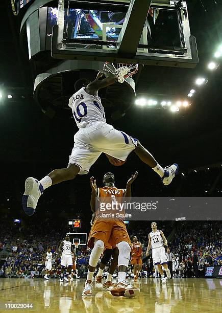 Tyshawn Taylor of the Kansas Jayhawks dunks the ball against the Texas Longhorns in the first half of the 2011 Phillips 66 Big 12 Men's Basketball...