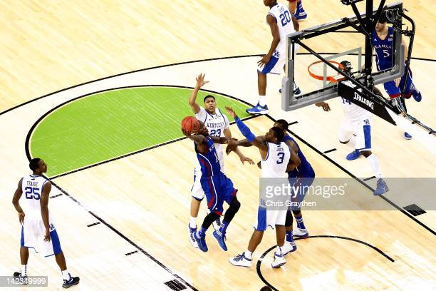 Tyshawn Taylor of the Kansas Jayhawks goes up for a shot against Terrence Jones of the Kentucky Wildcats in the second half in the National...