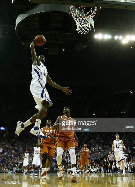 Tyshawn Taylor of the Kansas Jayhawks goes up to dunk the ball against the Texas Longhorns in the first half of the 2011 Phillips 66 Big 12 Men's...