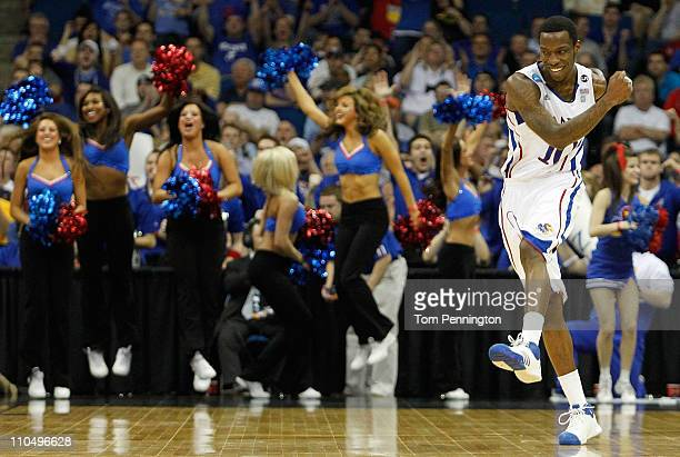 Tyshawn Taylor of the Kansas Jayhawks reacts to a play during their 5973 win over the Illinois Fighting Illini in the third round of the 2011 NCAA...
