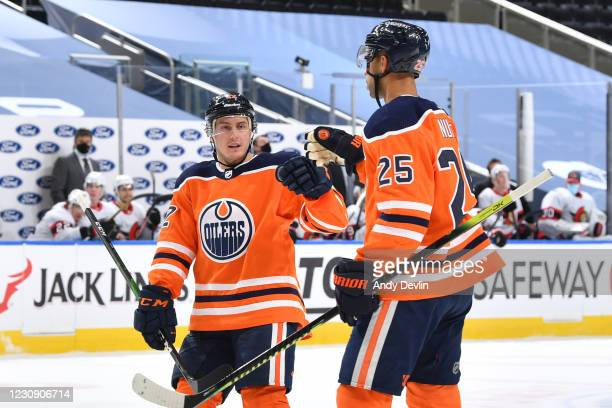 Tyson Barrie and Darnell Nurse of the Edmonton Oilers celebrate after a goal during the game against the Ottawa Senators on January 31, 2021 at...