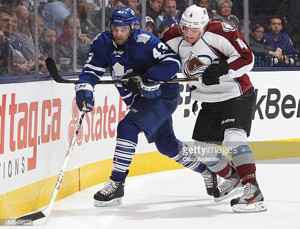 Tyson Barrie of the Colorado Avalanche battles against Nazem Kadri of the Toronto Maple Leafs during an NHL game at the Air Canada Centre on October...