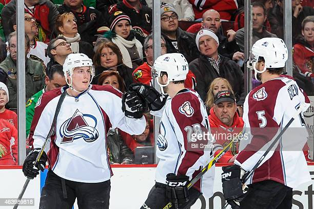 Tyson Barrie of the Colorado Avalanche celebrates with Paul Carey and Nate Guenin after scoring in the first period against the Chicago Blackhawks...