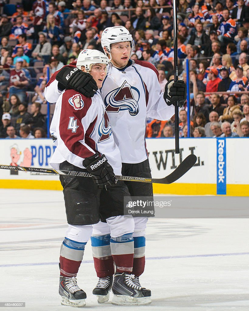 Tyson Barrie #4 of the Colorado Avalanche is congratulated by teammate Erik Johnson #6 after scoring against the Edmonton Oilers during an NHL game at Rexall Place on April 8, 2014 in Edmonton, Alberta, Canada. The Avalanche defeated the Oilers 4-1.