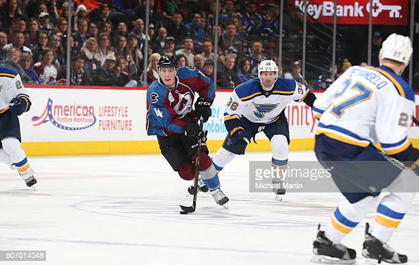 Tyson Barrie of the Colorado Avalanche skates with the puck against the St Louis Blues at the Pepsi Center on January 22 2016 in Denver Colorado The...