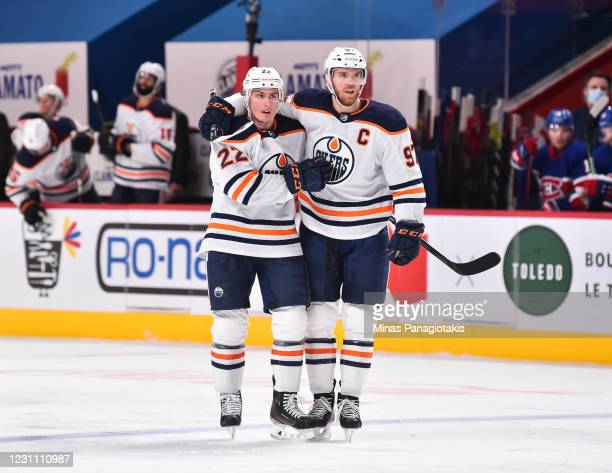 Tyson Barrie of the Edmonton Oilers celebrates his goal with teammate Connor McDavid during the third period against the Montreal Canadiens at the...