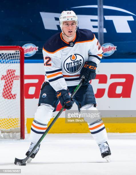 Tyson Barrie of the Edmonton Oilers holds the puck against the Toronto Maple Leafs during the second period at the Scotiabank Arena on March 27, 2021...