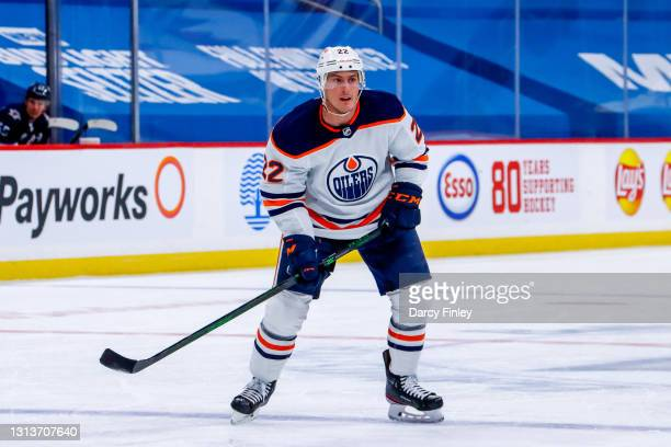 Tyson Barrie of the Edmonton Oilers keeps an eye on the play during second period action against the Winnipeg Jets at Bell MTS Place on April 17,...