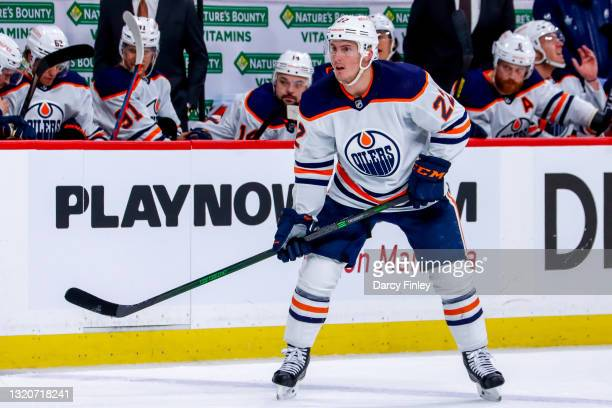 Tyson Barrie of the Edmonton Oilers keeps an eye on the play during second period action against the Winnipeg Jets in Game Four of the First Round of...