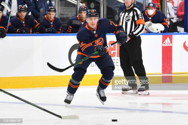 Tyson Barrie of the Edmonton Oilers passes the puck during the game against the Calgary Flames on March 6, 2021 at Rogers Place in Edmonton, Alberta,...