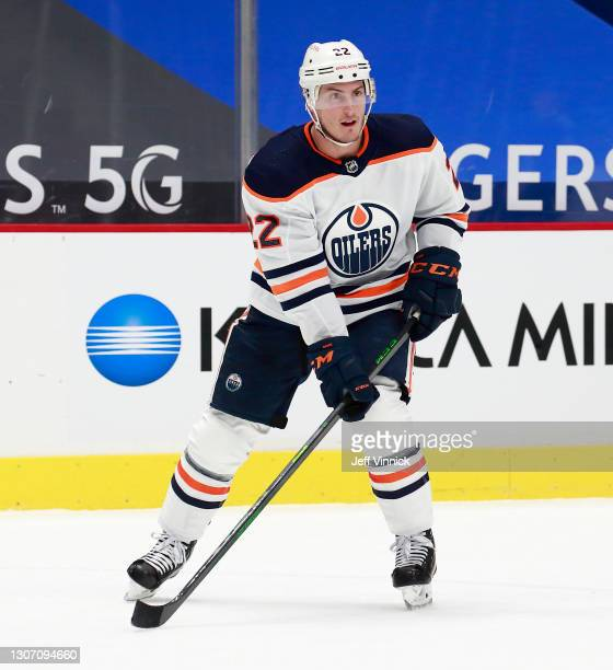 Tyson Barrie of the Edmonton Oilers skates up ice during their NHL game against the Vancouver Canucks at Rogers Arena on March 13, 2021 in Vancouver,...