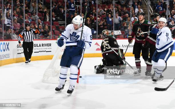 Tyson Barrie of the Toronto Maple Leafs celebrates after scoring a goal against the Arizona Coyotes during the first period at Gila River Arena on...