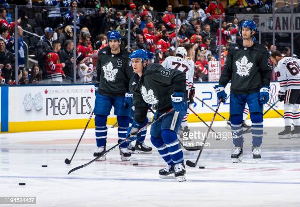 Tyson Barrie of the Toronto Maple Leafs wears a jersey honouring the Canadian Armed Forces during warmup before facing the Chicago Blackhawks at the...
