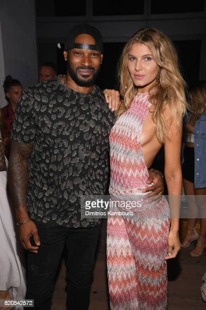 Tyson Beckford and model attend the SWIMMIAMI KAOHS 2018 Collection fashion show at WET Deck at W South Beach on July 21 2017 in Miami Beach Florida