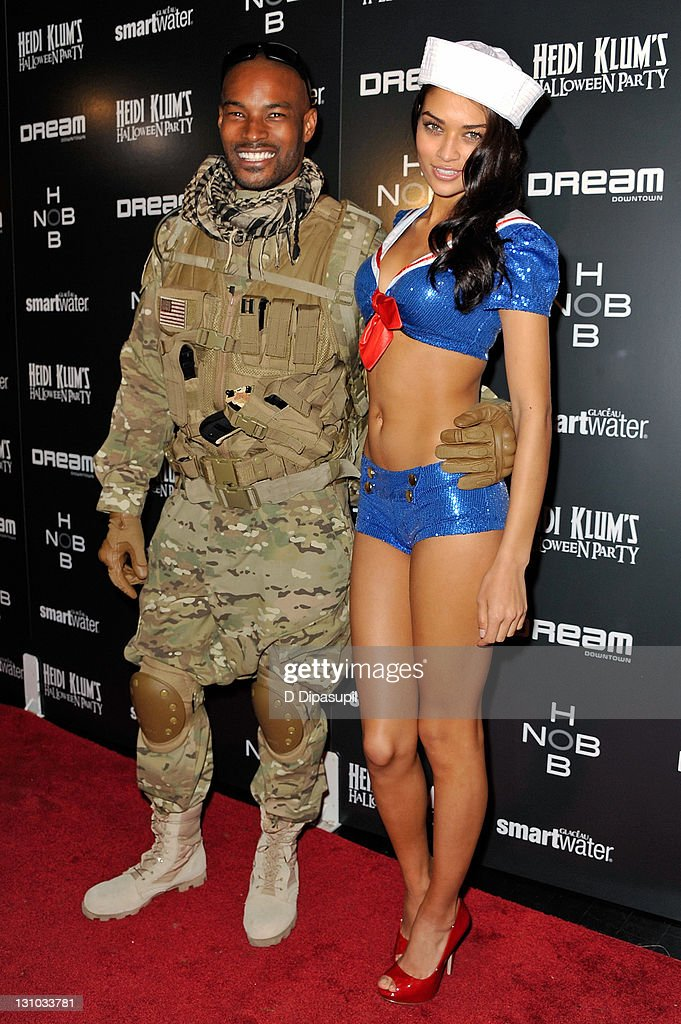 Tyson Beckford (L) and Shanina Shaik attend Heidi Klum's 12th annual Halloween party at the PH-D Rooftop Lounge at Dream Downtown on October 31, 2011 in New York City.