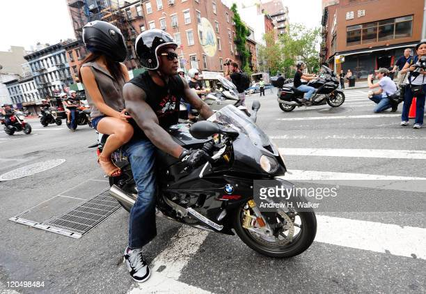 Tyson Beckford arrives on a BMW motorcycle at Kiehl's LifeRide for amfAR Block Party at Kiehl's Since 1851 New York Flagship Store on August 6, 2011...