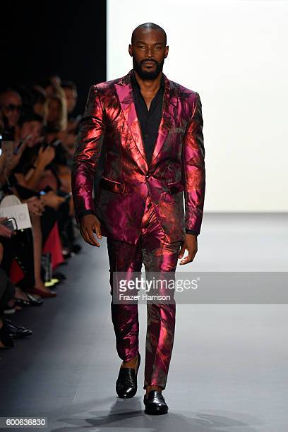Tyson Beckford walks the runway at the Michael Costello fashion show during New York Fashion Week The Shows September 2016 at The Dock Skylight at...