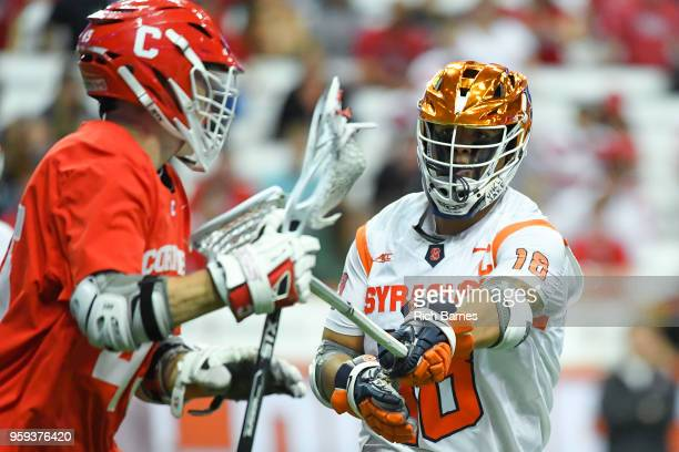 Tyson Bomberry of the Syracuse Orange checks Clarke Petterson of the Cornell Big Red during a 2018 NCAA Division I Men's Lacrosse Championship First...
