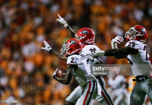Tyson Campbell of the Georgia Bulldogs celebrates catching an interception against the Tennessee Volunteers during the third quarter of the game at...