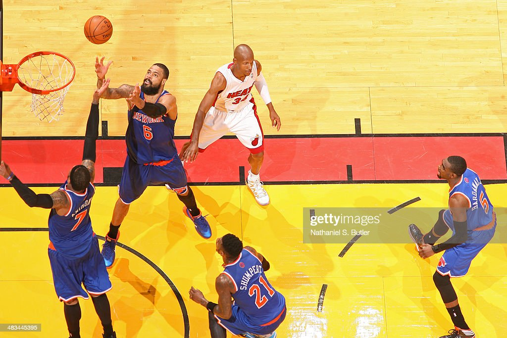 Tyson Chandler #6 and Carmelo Anthony #7 of the New York Knicks attempt to rebound the ball during the game against the Miami Heat on April 6, 2014 at American Airlines Arena in Miami, Florida.