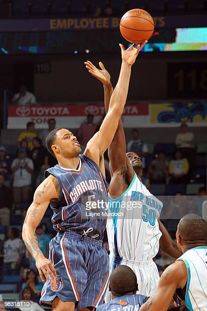Tyson Chandler of the Charlotte Bobcats and Emeka Okafor of the New Orleans Hornets reach for a jump ball on April 7 2010 at the New Orleans Arena in...