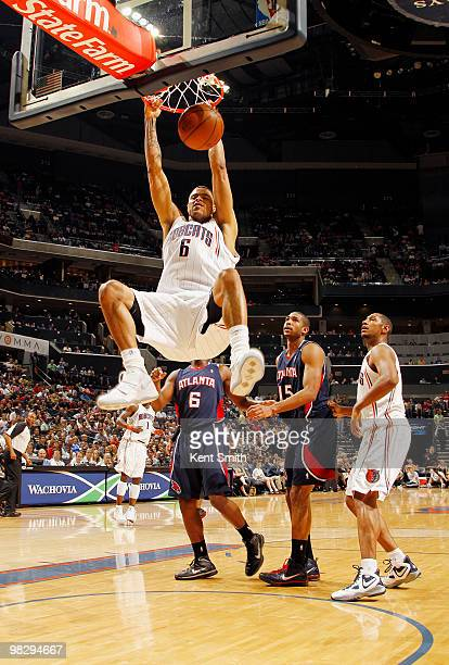 Tyson Chandler of the Charlotte Bobcats dunks against Al Horford of the Atlanta Hawks on April 6 2010 at the Time Warner Cable Arena in Charlotte...